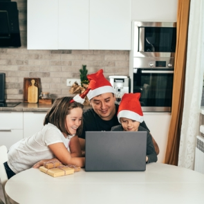 Dad and two children video chatting online on the occasion of Christmas celebration. Holiday at home